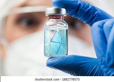 UK lab scientist biotechnologist holding glass ampoule vial with DNA strand,molecule of two polynucleotide chains forming double helix carrying Coronavirus genetic instruction,new strain RNA mutation