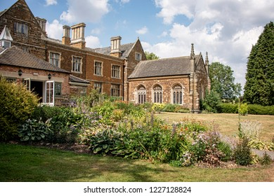 UK, Launde Abbey, Leicestershire - July 2018: Once home to the Cromwell Family and now a christian retreat Launde Abbey was founded 1119 by Richard Basset, a royal official of Henry I. Rear & chapel.
