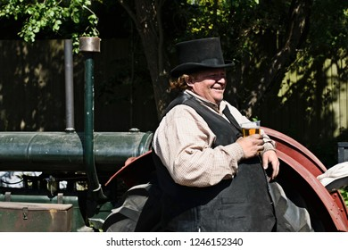 UK, Leicester shire, Quorn, Great Central Railway - 07-06-2018: Victory Day Celebration Event - reenactor takes a well earned pint whilst minding his steam engine