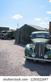 UK, Leicester shire, Quorn, Great Central Railway - 07-06-2015: Vintage military vehicles parked outside of army tents as part of a war day re-enactment