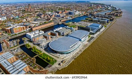 UK, LIVERPOOL - AUGUST 05, 2017: Aerial View of Liverpool City Photo with Docks, Wheel, Modern Buildings feat. Liverpool Cathedral and Mersey River on a Sunny Day in England