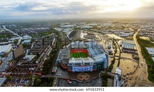 UK, MANCHESTER - JUNE 07, 2017: Aerial View Image Photo of Iconic Manchester United Stadium Arena Old Trafford Football Ground Flying Over