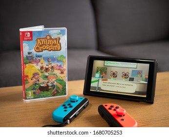 UK, March 2020: Nintendo switch with joy con controllers and new animal crossing new horizons