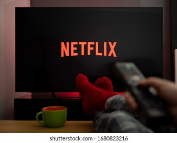 UK, March 2020: TV Television feet up watching Netflix on tv