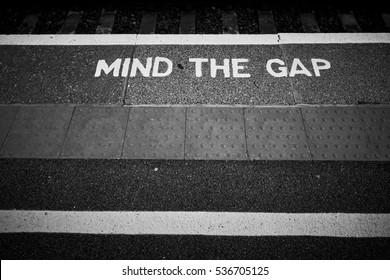 UK 'Mind the gap' sign on train platform