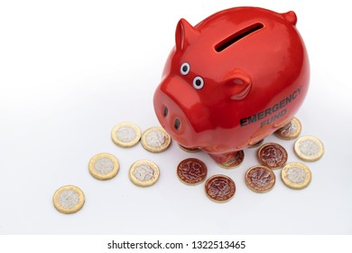 UK money crisis, red piggy bank with pound coins