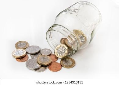 UK money falling from jar