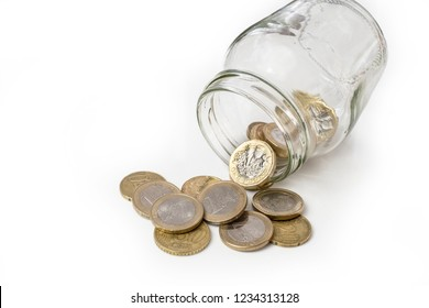 UK money falling from jar, changing ito euro coins