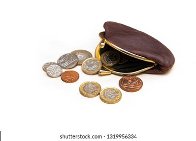 UK money in old purse, image shows open purse with money inside and out, new pound coins and smaller