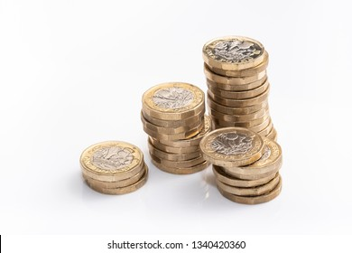 UK money, pound coins in small piles, money budget