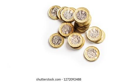 UK money, pound coins stack on white background