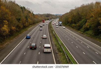 A UK motorway, with limited traffic, on an autumn day