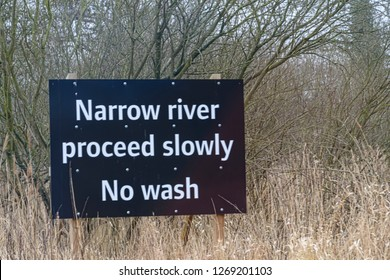 UK, NORFOLK - MARCH 2018; Instruction sign for boats, Narrow River proceed slowly. No wash.