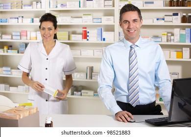 UK nurse and pharmacist working in pharmacy