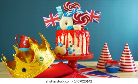 UK on-trend candyland fantasy drip cake with red, white and blue decorations, lollipops and flags.