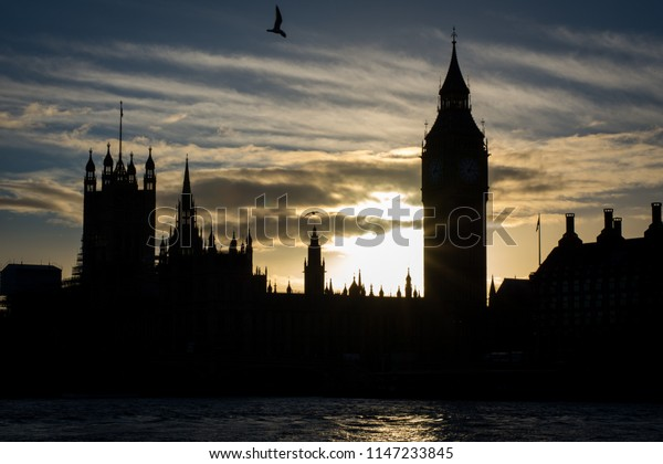 UK Parliament and Big Ben at sunset. Shot from River Thames.