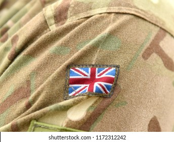 UK patch flag on soldiers arm. UK military uniform. United Kingdom troops