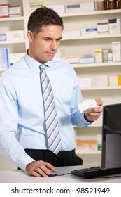 UK pharmacist working on computer