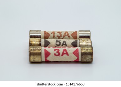 UK plug fuses 3 Amps 5 Amps and 13 Amps on a white background
