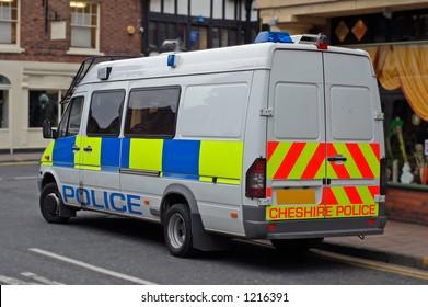 UK Police riot van in city centre