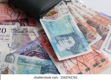 UK pound,money of United kingdom close up on white, Pound UK note in wallet