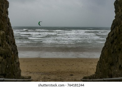 UK Weather: St Michaels Mount, Cornwall, UK. Windsurfers make the most of gale froce winds along the beach at St Micaels Mount
