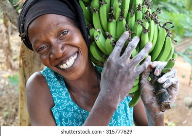 UKEREWE ISLAND - TANZANIA - JULY 4, 2015: Unidentified woman carrying bananas on July 4, 2015 in a rural village on Ukerewe Island, Lake Victoria, Tanzania