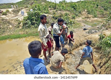 UKHIA, COX'S BAZAR, BANGLADESH, MARCH 05, 2018: Rohingya people are having dirty water during coming back to their home at Refugee camp in Ukhia, Cox's Bazar after collecting firewood from forest.
