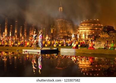 UKHOTHAI, THAILAND - NOV 28: Traditional Thai  in Loy Krathong festival showing (raft float on water) in Wat Mahathat, Sukhothai historical park. November 28, 2012 in Sukhothai, Thailand.