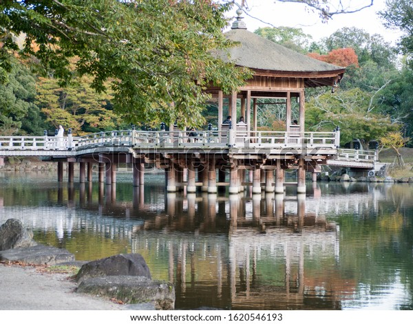 Ukimido floating pavilion reflecting in the lake in Nara deer park in autumn