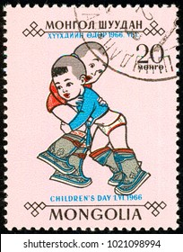 Ukraine - around 2018. The postage stamp printed in Mongolia shows playing children. The Mongolian traditional sport is wrestling. Series: Day of the child. Circa 1966.