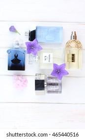 Ukraine - August 7, 2016: Perfumes and cosmetics set on white background: Chanel, Dolce & Gabbana, Yves Saint Laurent, Guerlain