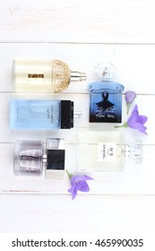 Ukraine - August 7, 2016: Perfumes and cosmetics set on white background: Chanel, Dolce & Gabbana, Yves Saint Laurent, Guerlain, Clinique, Givenchy, Sisley