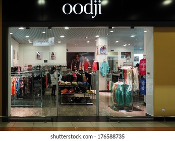 UKRAINE, BORISPOL, KIEV REGION - FEBRUARY 12, 2014: Oodji store in Aeromall.  OGGI is a Russian youth fashion chain. OGGI means development and production of clothes for girls and young women.