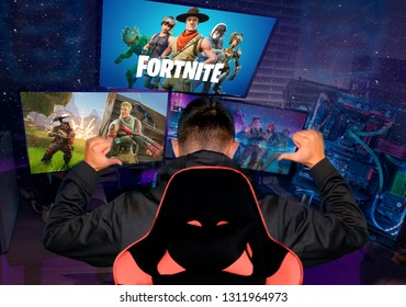 Ukraine, Cherkassy - January 13, 2019: Teenager gamer playing Fortnite video game, Fortnite is a web based multi player survival game developed by Epic Games. shooter cybersport