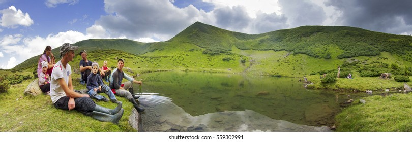 Ukraine, Chernaya Tisa, June 7, 2013: Shepherds Gutsul cows and sheep along with the families of their wives and children resting on a mountain lake in the Carpathians Vorozheska