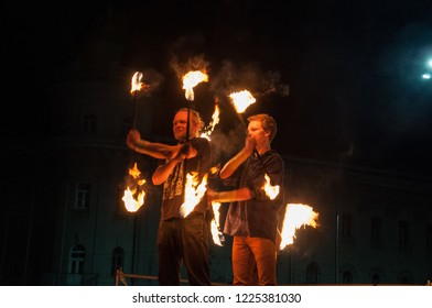Ukraine, Chernihiv, April 16, 2016: a city holiday, the opening of the tourist season in Chernihiv. Fire show in the evening, dance with fire, fakir girl guy. International Tourism Day