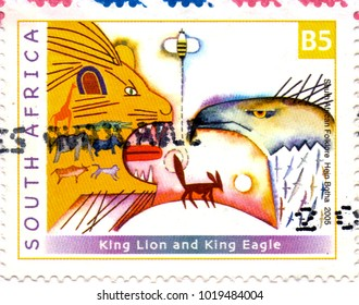 Ukraine - circa 2018: A postage stamp printed in South Africa show close-up of a lion, eagle and other animals. Inscription South African Folklore Hein Botha 2005. Circa 2005.
