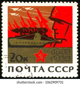 Ukraine - circa 2018: A postage stamp printed in USSR show Soldier and machines of war. Series: 20th Anniversary of Victory in the Second World War. Circa 1965.