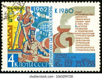 Ukraine - circa 2018: A postage stamp printed in USSR show propaganda poster Building and statistics. Forecast until 1980. Series: Resolution of 22nd Communist Party Congress. Circa 1962.