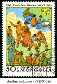 Ukraine - circa 2018: A postage stamp printed in Mongolia shows Wrestling, Mongolian National Sport. Series: International Decade for Women. Circa 1981