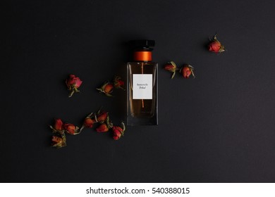 Ukraine - december 3, 2016: Perfumes set on black background with dry roses: Givenchy