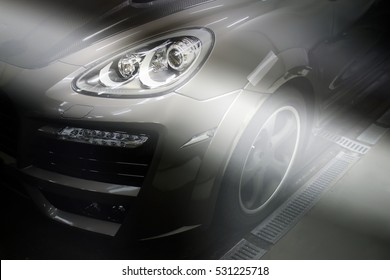 Ukraine, Dnepr. December 10, 2015. Porsche Cayenne Turbo TechArt Magnum. Car headlights. Luxury Headlights. Editorial photo.
