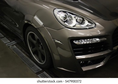 Ukraine, Dnepr. December 11, 2015. Porsche Cayenne Turbo TechArt Magnum. Car headlights. Luxury Headlights. Editorial photo.