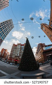 Ukraine, Dnepropetrovsk - DECEMBER 12, 2015: Buildings, streets and yards. Tourists and residents of the city. Photo taken fish-eye lens.