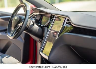 Ukraine, Dnipro June 20 - 2020:  Tesla car displays touchpad. Tesla car interior.