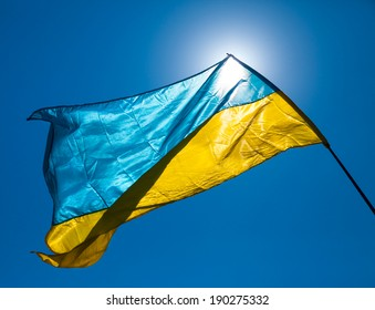 Ukraine flag waving on the wind against the blue sky