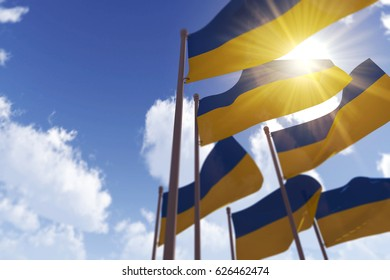 Ukraine flags waving in the wind against a blue sky. 3D Rendering