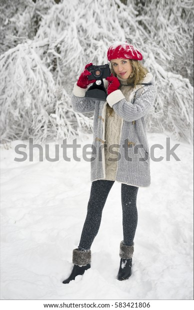 Ukraine, Ivano-Frankivsk, 28/12/2014: Young longhaired Slavic European beautiful Ukrainian girl on the background of wild nature in winter frosty weather on sunny meadow walks