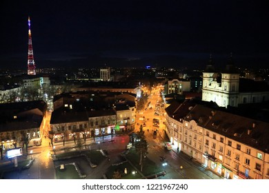 UKRAINE, IVANO-FRANKIVSK, FEBRUARY 23, 2017: View on night city from Ratusha or Town Hall in Ivano-Frankivsk city, building in city center on Rynok or Market Square